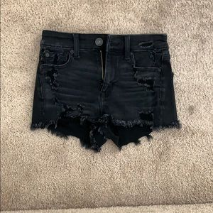 Black jean shorts with rips in front